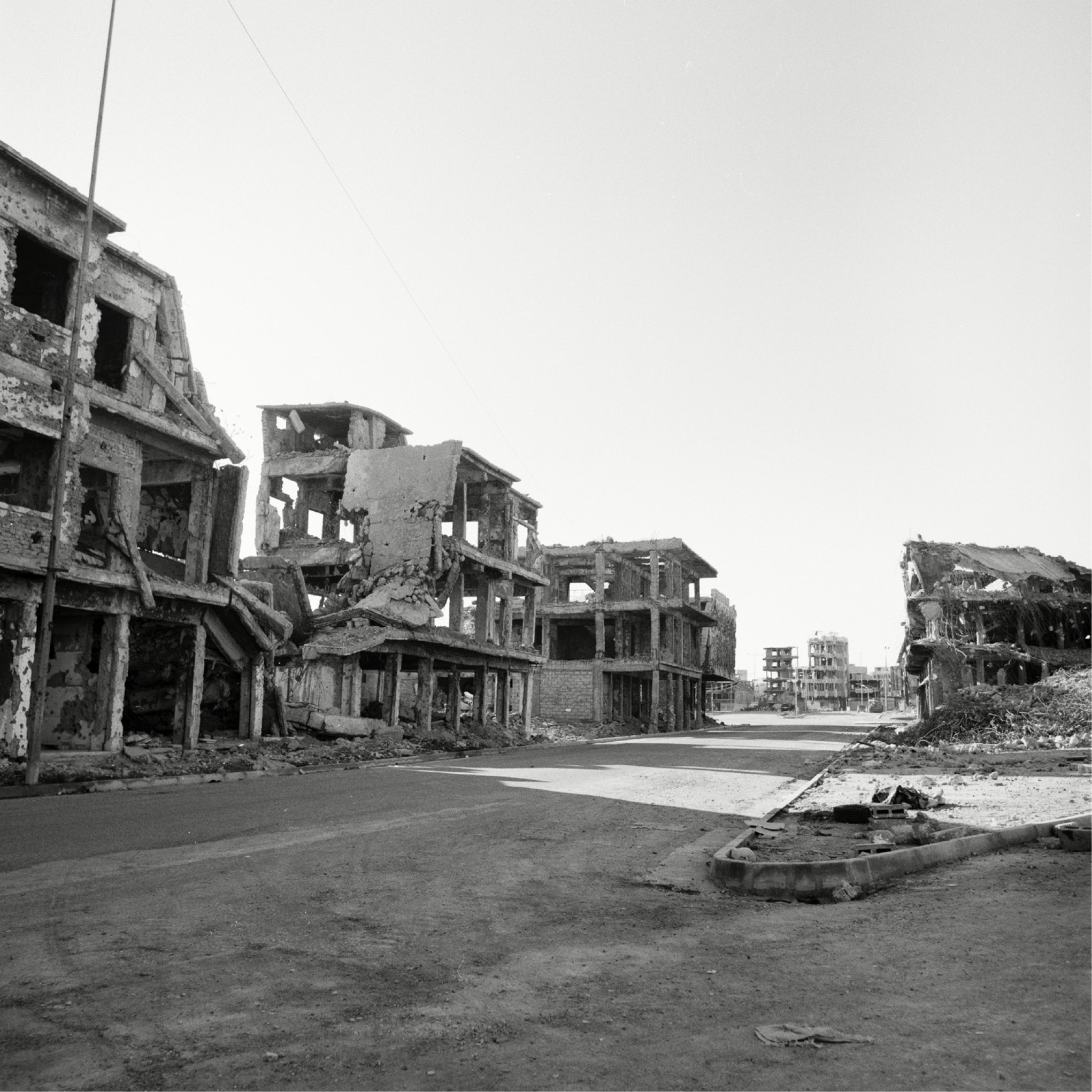 Black and white photograph of war ravaged street